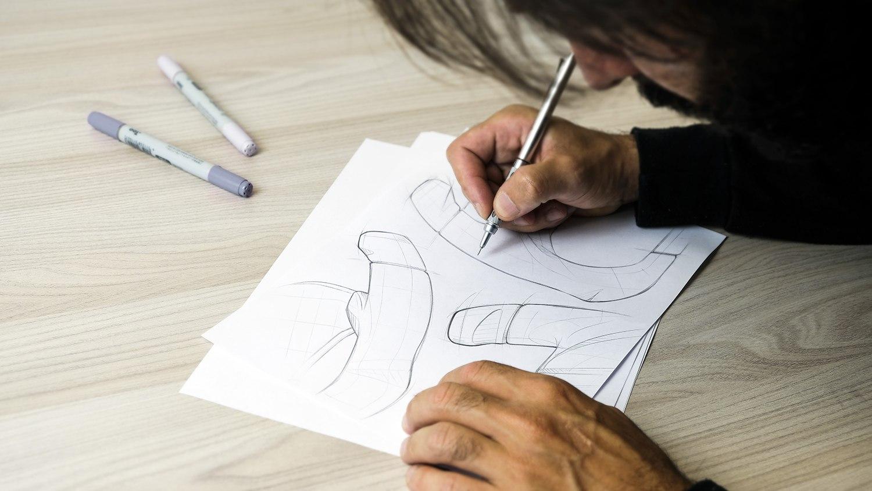 Massimo Cubeddu - Cube Controls Lead Designer - sketching the GT Pro Zero sim racing wheel